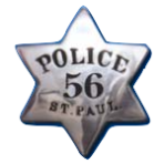 This is the first official badge of the Saint Paul Police Department. It was first issued in 1856 and worn for nearly 35 years. According to the Saint Paul Police Historical Society website, this badge style was common.