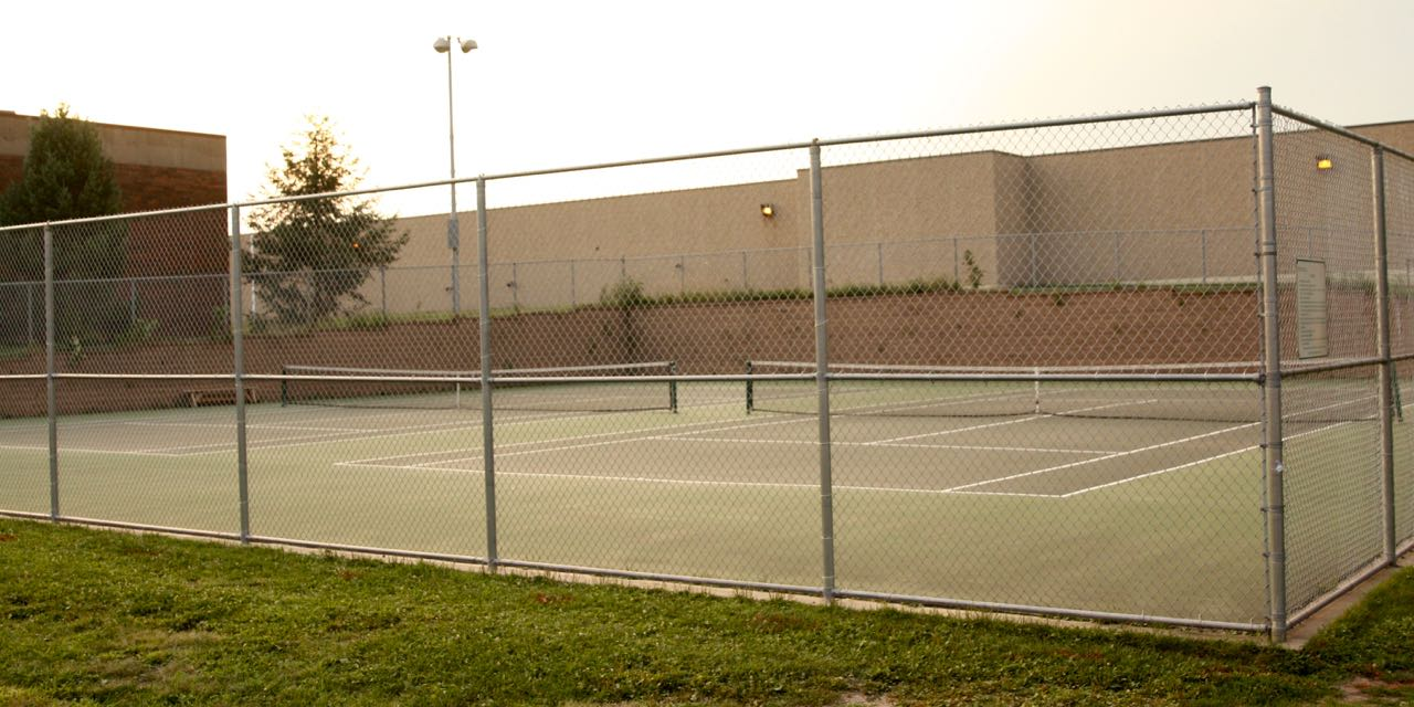"These tennis courts are dedicated to Ernie ""Duke"" Greene, an early African American champion of tennis in Saint Paul."