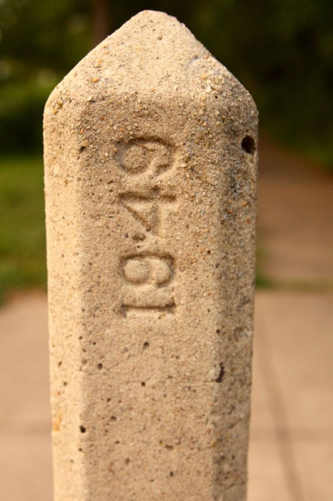 A close look at the date mark on the top of the concrete obelisk.
