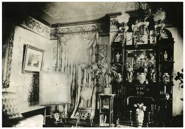 The parlor of the Frederick Banholzer home shows the jumble of of knickknacks and furniture common in Victorian era decorating. This photo was taken in 1885 shortly after the house was completed. Courtesy Minnesota Historical Society