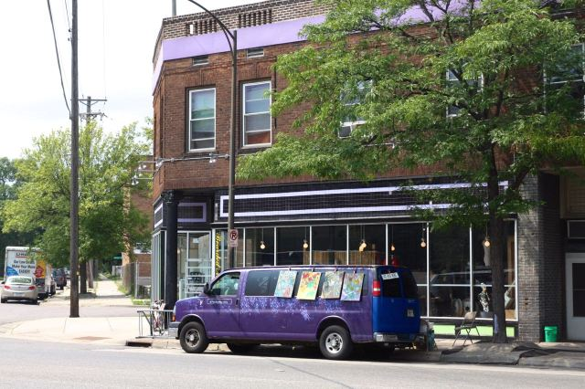 The purple van adorned with paintings required my investigation.