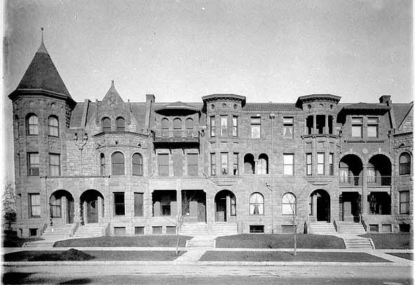 The eight unit row house that has been known as Summit Terrace and now, F. Scott Fitzgerald Row Houses was built in 1889, two years before this picture was taken. The brownstone was designed by noted Minnesota architect Clarence Johnston. Courtesy Minnesota Historical Society.