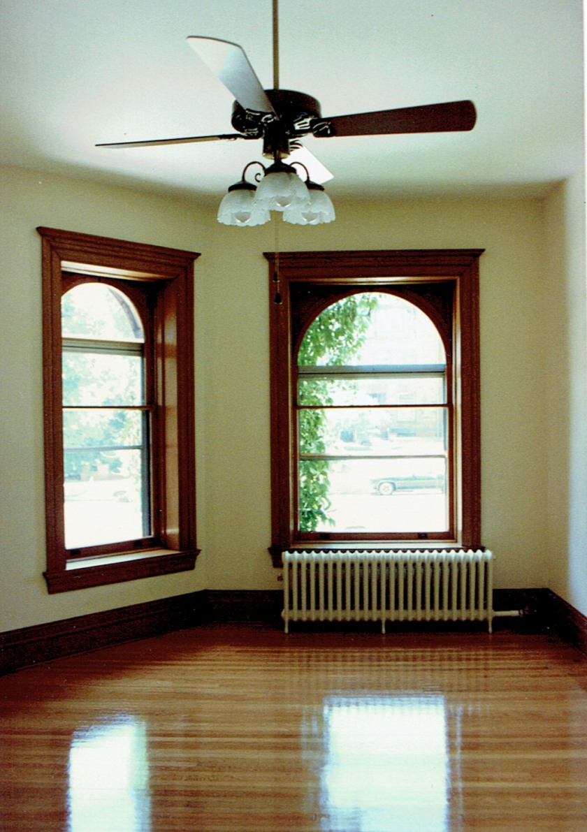 The difference between the front room Dick inherited and how it looked as his renovations neared completion is startling. The natural woodwork and gorgeous hardwood floors added an elegance reminiscent of when the building was new. Photo courtesy of Dick Tollefson.