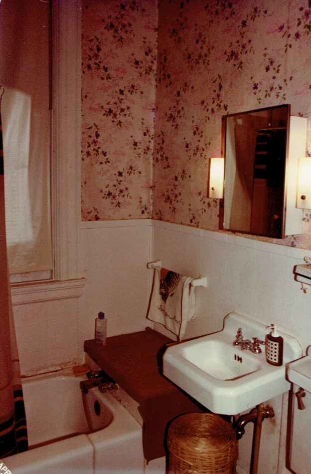 One of the bathrooms was in dire shape in 1983 when Dick took this picture. Notice the window trim was painted white and there is water damage around the bathtub. Photo courtesy Dick Tollefson.
