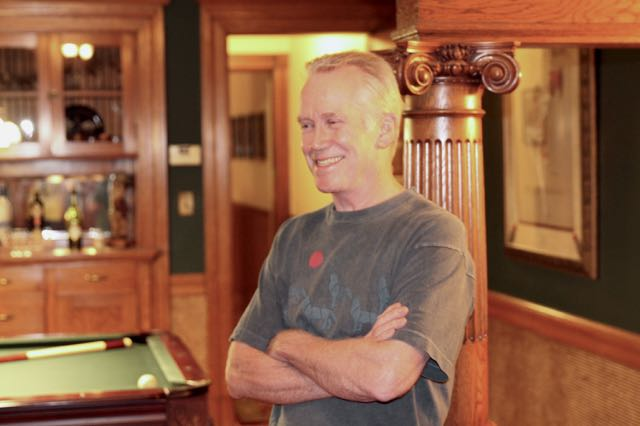 Dick Tollefson standing just outside of his pool room.