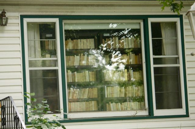 No need for curtains in the front window at 1024 Kiburn Street with the fully stocked bookshelf.