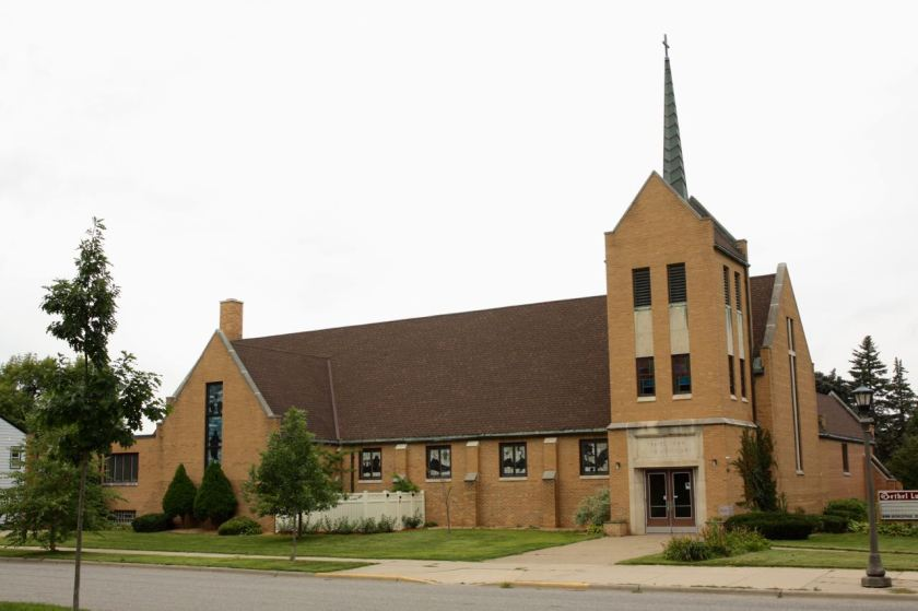 Bethel Lutheran Church dominates the southwest corner of Wheelock Parkway and North Maywood Street.