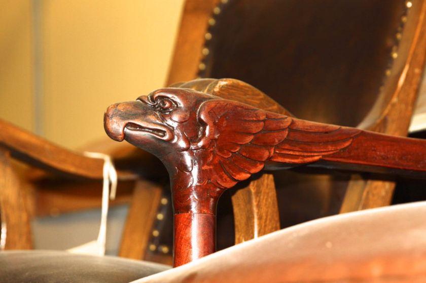 A close up the armrest on an original Cass Gilbert-designed chair from the Minnesota Capitol.