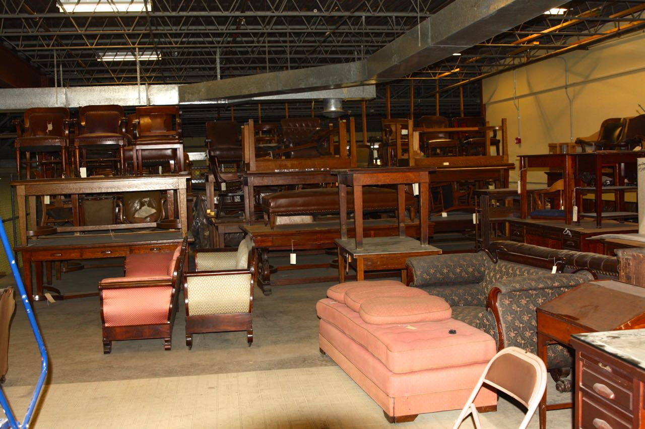 Many of the tables and sofas stored in this area are of Gilbert's design.)