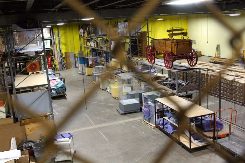 The storage area for the Capitol furniture overlooks a less secure repository area holding boxes of files, display cases and a few artifacts.