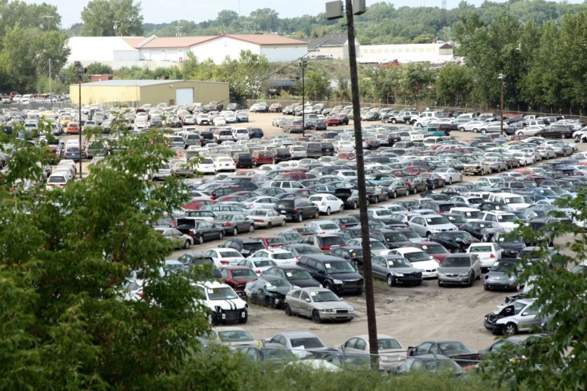 This large lot of vehicles in various states of functionality lies in a depression between Jackson Street and I-35E, north of Maryland Avenue.
