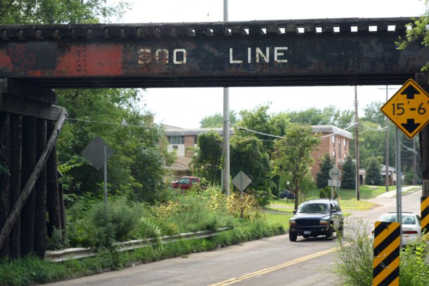 The railroad bridge over Arlington Avenue is between Trout Brook Cirlce and Sylvan Street. The 1953 structure still wears its Soo Line livery, although the Canadian Pacific Railroad swallowed the Soo in the 1990s.