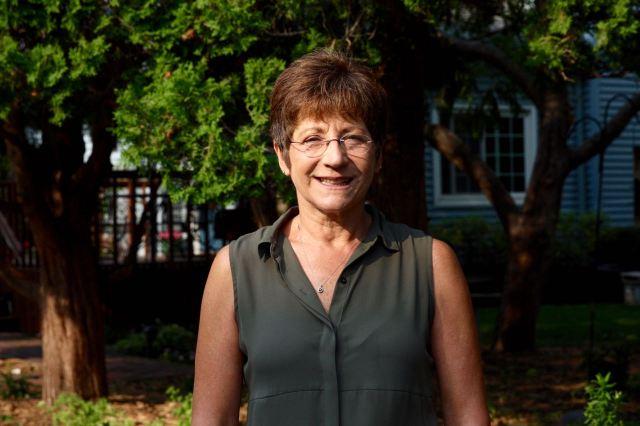 Cathy Trana in her yard.