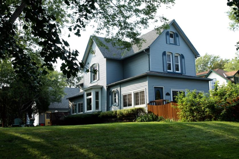 The beautiful grey-blue house at the corner of Orange Avenue West and Mackubin Street is the original farmstead for this part of Saint Paul.