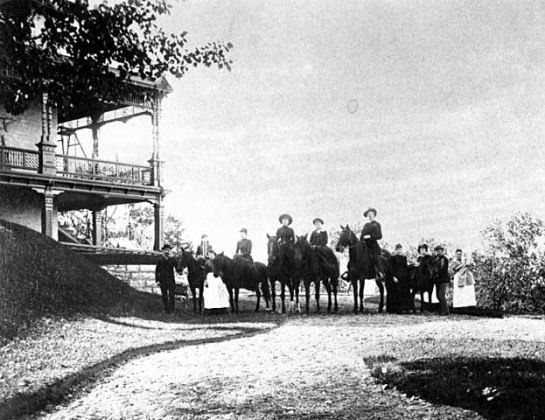 The Albert Scheffer family on horseback next to the residence circa 1900. Courtesy MnHS
