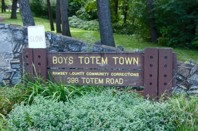 "Could Boys Totem Town be an oddly named park? Based upon the look of the sign, yes, until you notice the small print saying ""Ramsey County Community Corrections."""