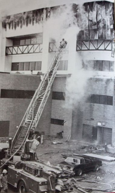 Firefighters use a hook and ladder rig to battle the arson fire at Central on May 13, 1980. Courtesy 1980 Central High School yearbook