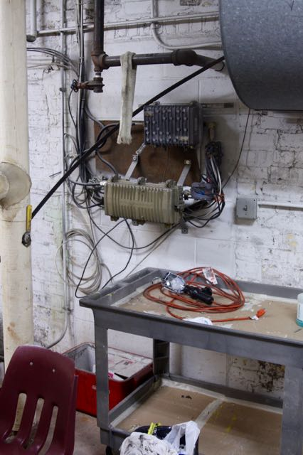 The brick behind the cable apparatus cover what was a doorway the custodians used to go between the boiler room and cafeteria.