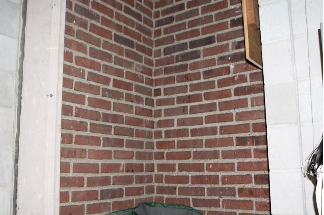 This was once an exterior corner of Central High. The light color cement on bordering the brick on the left is part of an exterior window frame.