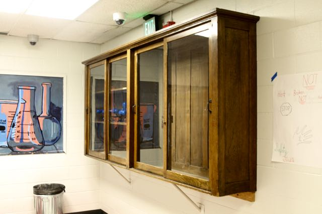 One of the cabinets from the 1912 building was hung in the 1979 science wing.