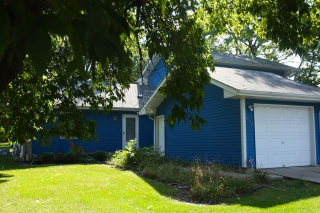 The deep blue house is at 510 Aurora.