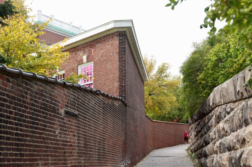 Closer to Summit Avenue, the stairs give way to a sidewalk. That's a corner of the Louis Hill Mansion on the left. Notice that a brick wall separates Louis's home and the stairs, while dad's is a stone wall.