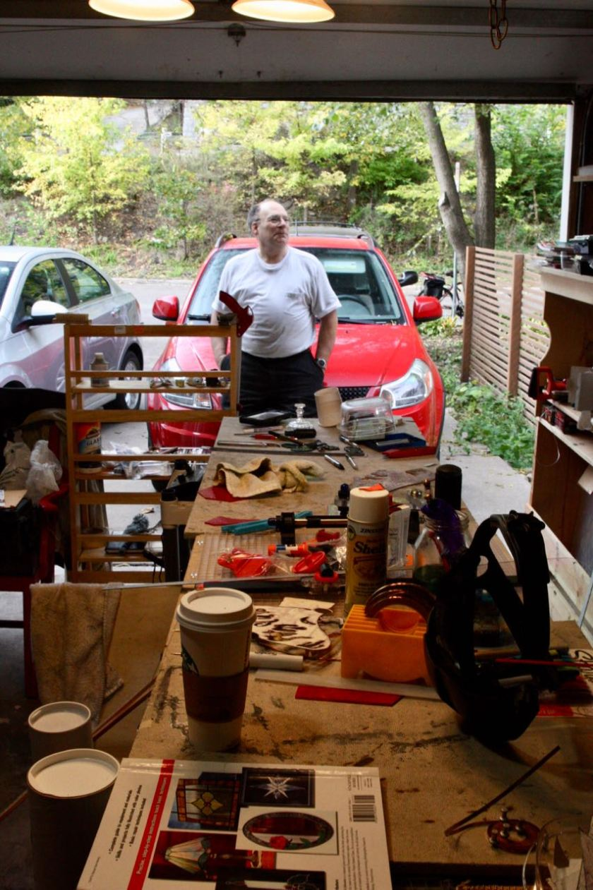 The stained glass workshop, with its hardware, chemicals and supplies, and glass - occupies a single car garage.