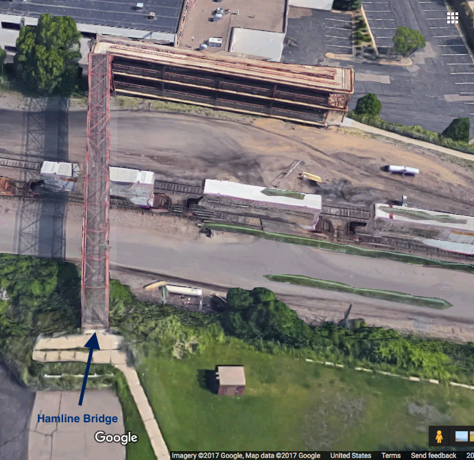 The Hamline Bridge carries pedestrian and bike traffic over two railroad tracks, and other railroad property. Courtesy Google Maps.