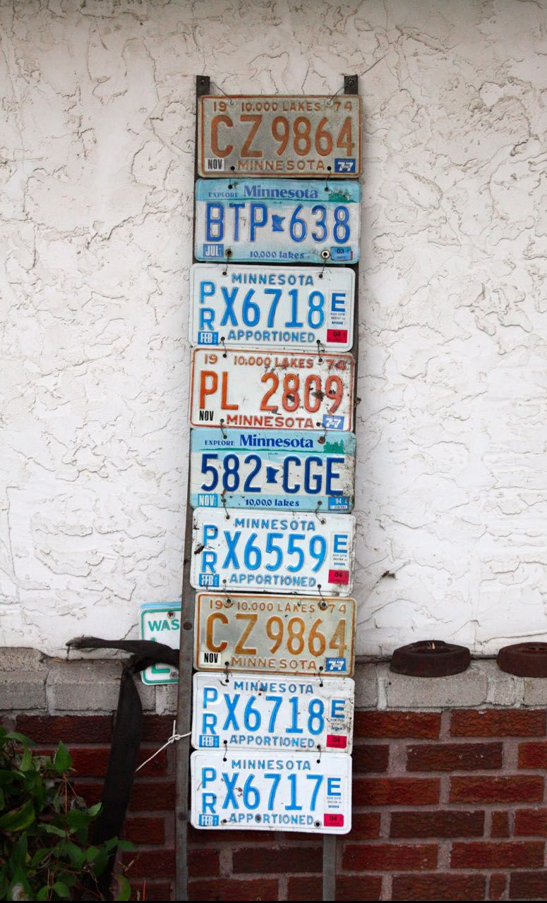 The Minnesota license plates decorate a ladder that was attached to the silo on her Great Grandfather's farm.