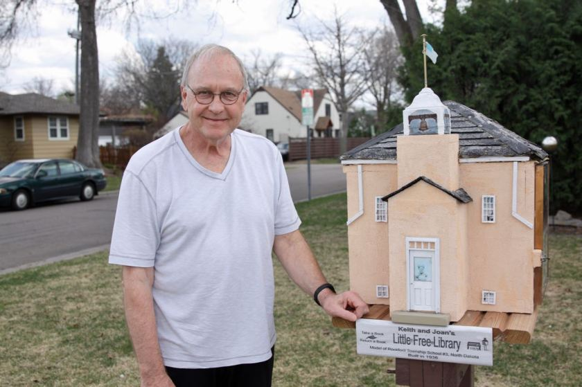 Keith Folker stands next to the Little Library replica of the Rockford Township School #3, where he went to school for six years in the mid-1950s.