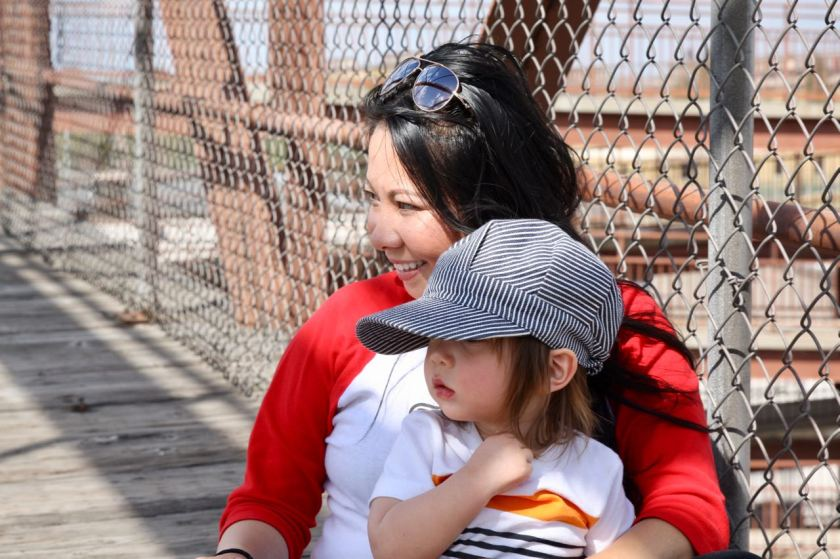 Martha Campo and her son, Owen, watch a nearby train from high above on the Hamline Pedestrian Bridge.