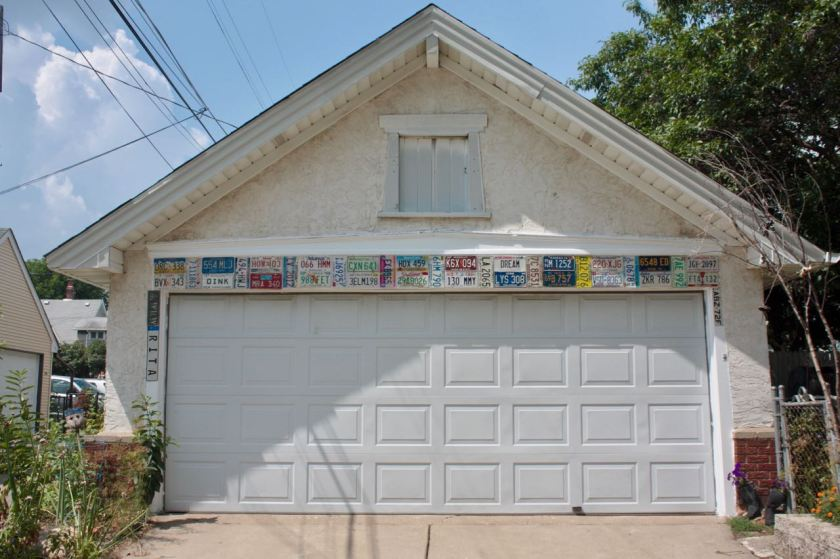 The trim on Rita Dahlbeck's garage is the main display of her wide-ranging collection of license plates.