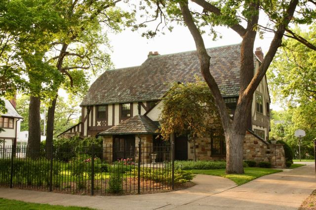 Several doors west is the English Tudor home at 2215 Summit.