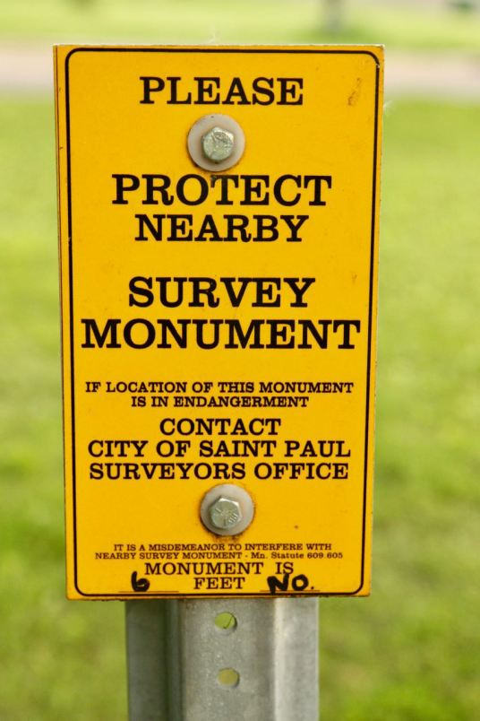 An official City of Saint Paul survey marker sign.