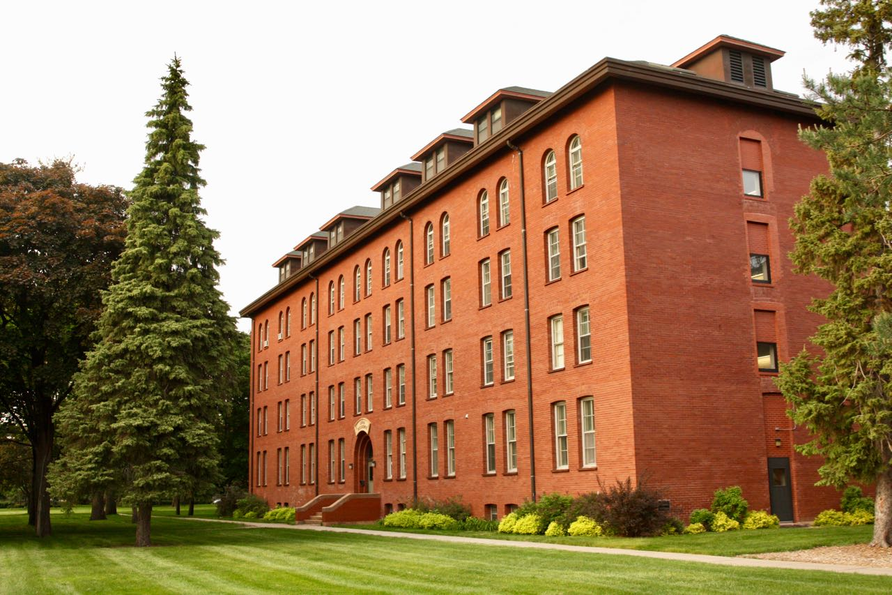 Loras Hall, originally called North Dormitory, was another Cass Gilbert design that was built in 1894 as a residence for Saint Paul Seminary students. Over its 120 plus-year history, Loras Hall also has been a residence for St. Thomas Academy high school students. The College (now University) of St. Thomas took possession of Loras Hall in 1982. Since its remodeling in the early 1990s, Loras Hall has housed University offices. (Thanks to Pat Sirek, UST, for this correction.)