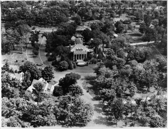 The mansion sits in the middle of this aerial photo from about 1930. It appears parcels of the former estate had been sold off by this time. There are a couple of other homes in the lower left corner of the picture. Photo courtesy MNHS.