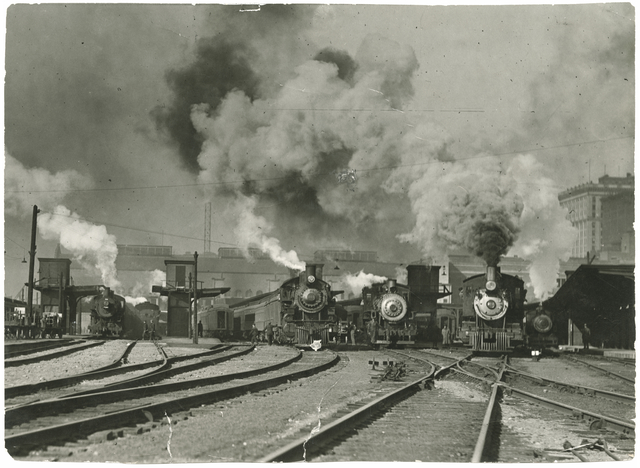 Several steam engines await passengers in the Union Depot yard in 1925. Photo courtesy Minnesota Historical Society.
