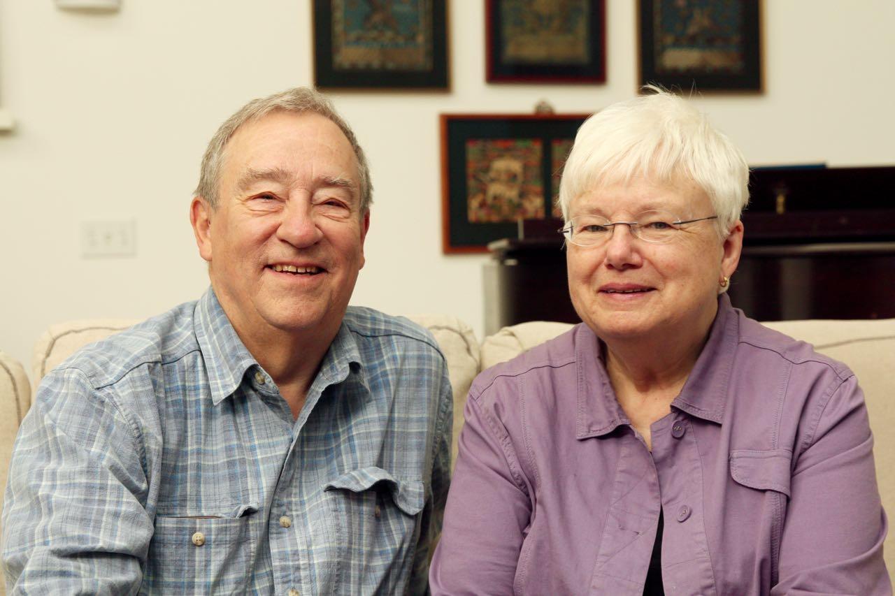 Ken and Ellen Green in the living room of their Union Depot condominium.