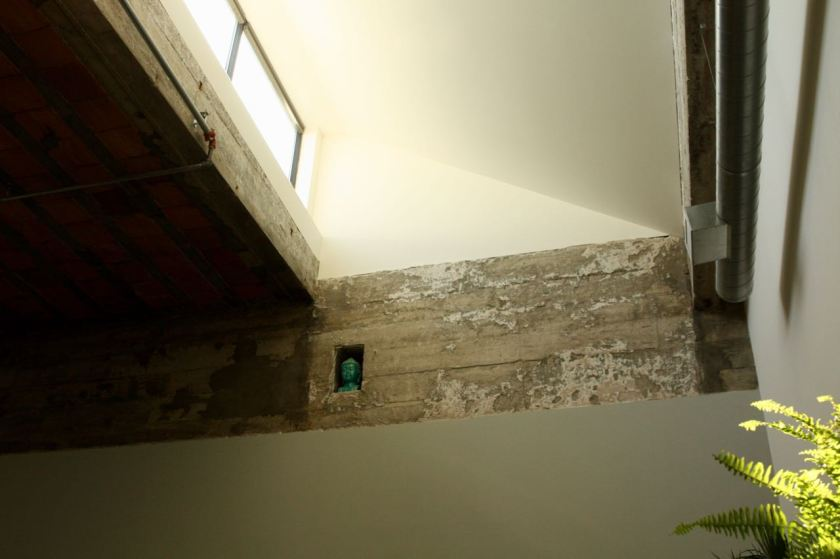 The most unusual feature of the Green's condo is location the windows, 20 or so feet above the main floor. Said Ellen,