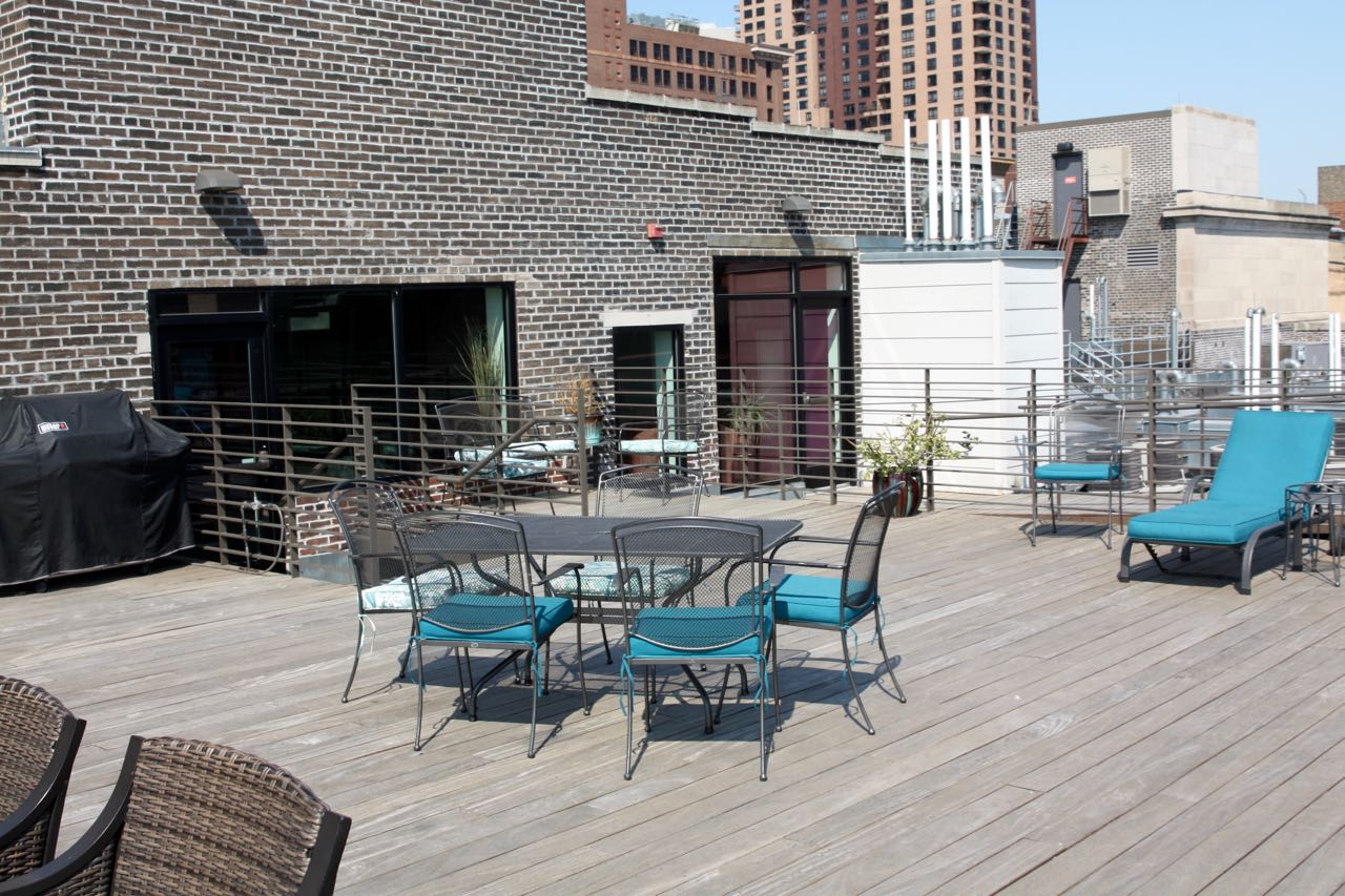 The condo dwellers have a deck overlooking Lowertown and the Mississippi River.