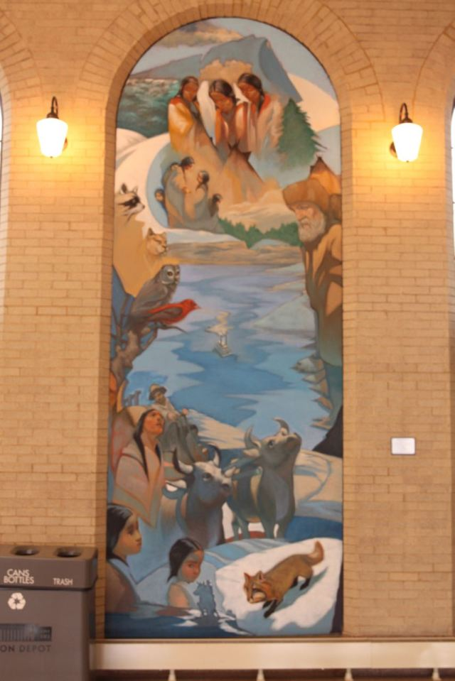 This is one of six murals by Ralph Gilbert inside the waiting room. It is about early times along the Mississippi River.