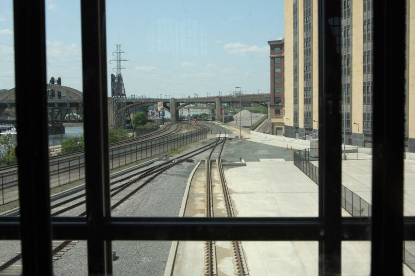The view west out a waiting room window. The building on the right is the former post office. It was renovated and transformed into the Custom House Apartments and a Hyatt Place Hotel. The Wabasha Street Bridge is in the background.