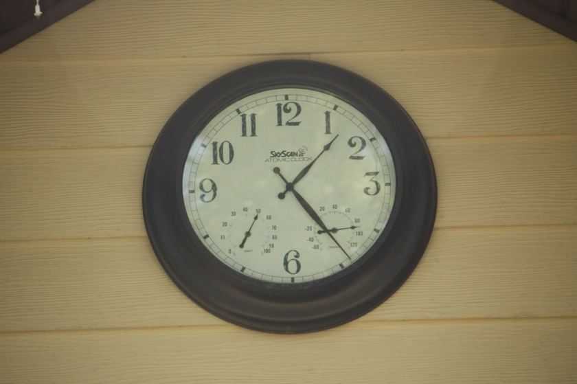Gene placed this clock on the peak of his house just below the roof line in front.
