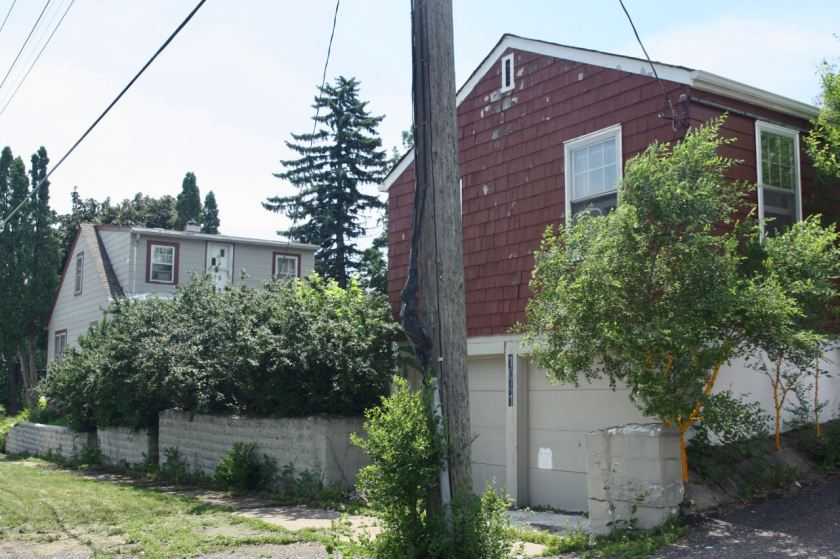 The alley house, in the foreground, sits atop a two car garage. You can see the back of the main house in this shot.