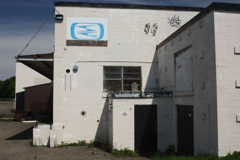 This blue logo was the only identifying mark on the building; not even the address was posted anywhere.