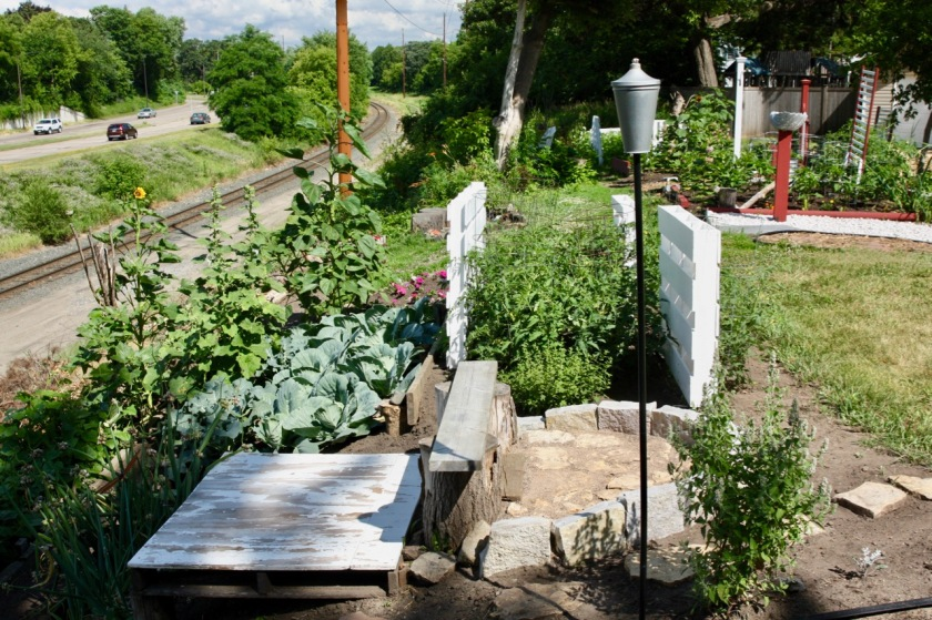Pallets, a crib, scrap lumber and bricks are among the discarded items Donna has reused in her gardens.