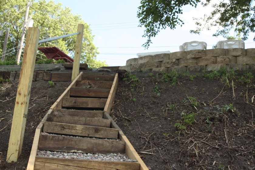 Donna built steps leading down from the sitting area to another garden.