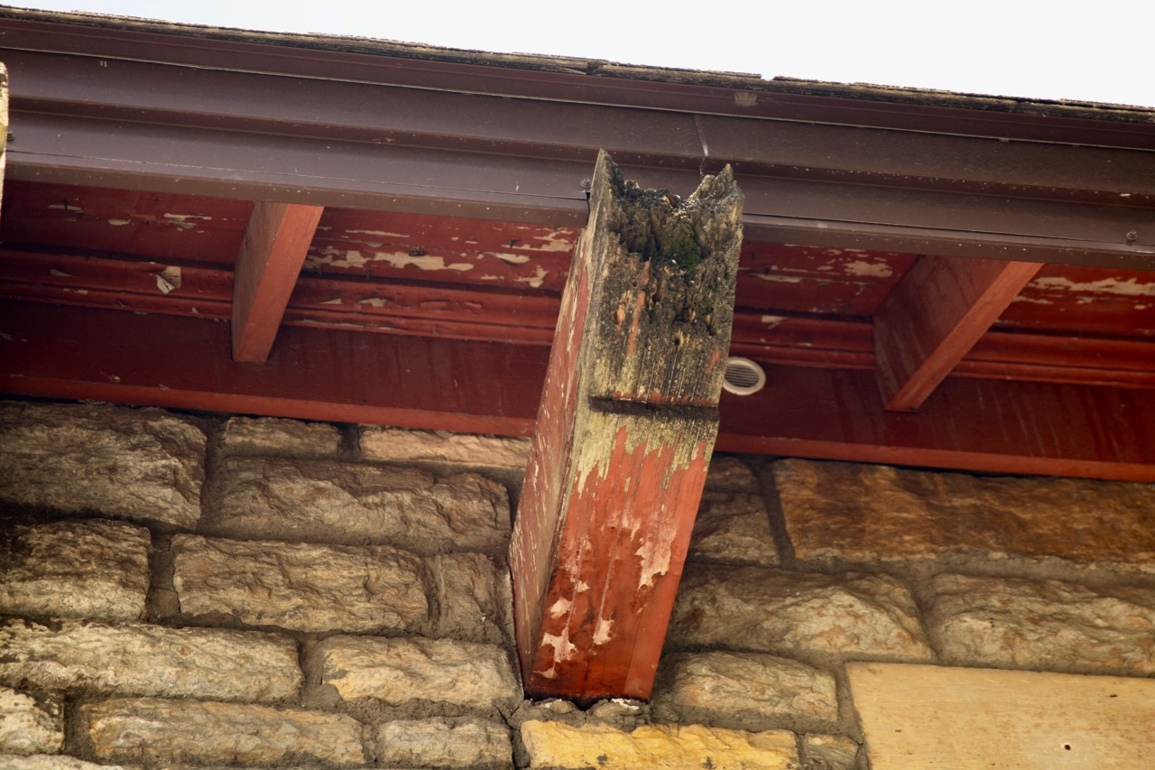 Signs of wear include pealing paint and rotting beams on the 1938 building.
