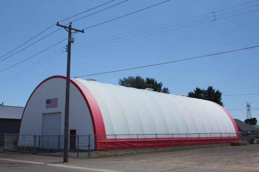 The Quonset hut-shaped building is on the south side of Burgess.