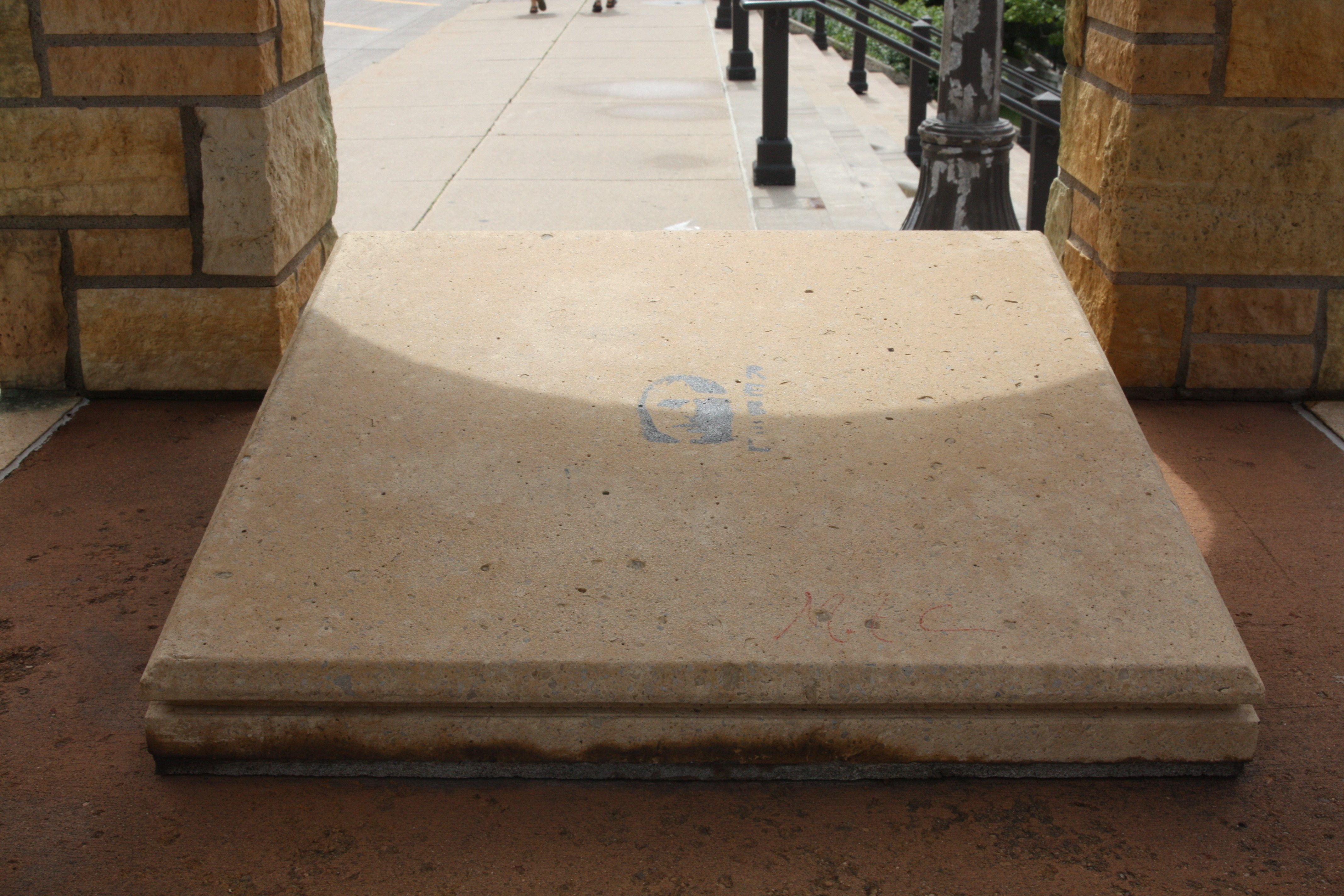 The slab is all that is inside the tower on Kellogg. I couldn't find a plaque or marker anywhere.